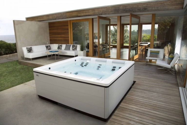 For those who own contemporary designed rental properties can choose a sleek Bullfrog Spas' STIL model like this one